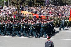 Russian soldiers march at the parade on annual victory day Stock Photos