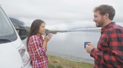 Traveling couple by mobile motor home RV campervan camping and enjoying Iceland Stock Footage
