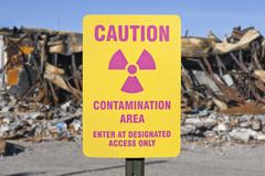 Contamination area warning sign with ruin Stock Photos