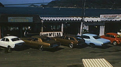 Acapulco 1975: cars parked in front of a shopping center - stock footage