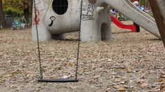 Empty Swing at Playgound Stock Footage