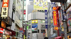 Pan Down of Busy Shibuya Shopping District Daytime - Tokyo Japan Stock Footage