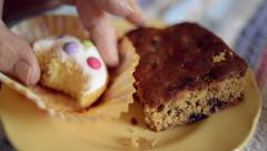 Coffee and cakes: close-up shot of senior man lifting homemade, iced cupcake Stock Footage