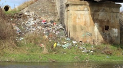 Garbage Along River Stock Footage