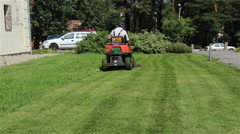 Gardener Mowing the Lawn Stock Footage