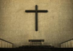 Stock Photo of cross on exterior wall of cathedral, vintage look.