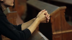 Girl Praying in Church Stock Footage