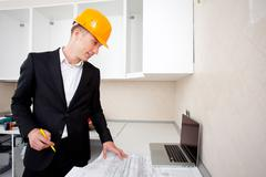 Civil engineer working with documents Stock Photos