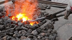 Heating the Iron on Forge  Fireplace Stock Footage