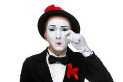 Portrait of thesad and crying mime - stock photo