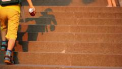 Kid Playing with Shaddow on Stairs Stock Footage