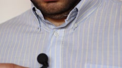 Lavalier Microphone and Shirt Stock Footage