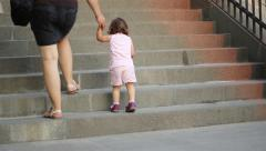 Little Girl Climbing Stairs Stock Footage
