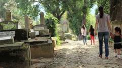 Little Girl Walking in Cemetery - stock footage