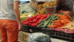 Man Buys Fresh Vegetables - stock footage