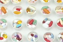 Medication cups Stock Photos