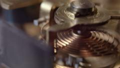 Close up of an internal watch mechanism, moving camera - stock footage