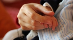 Mother Comforting Baby Hands Stock Footage