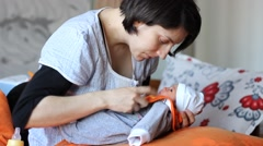 Mother Prepares to Feed Baby Stock Footage