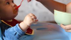 Parent Feeds Children - stock footage