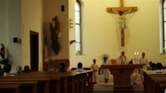 People in Benches Praying in Church Stock Footage