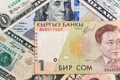 american dollars and kyrgyz money - stock photo