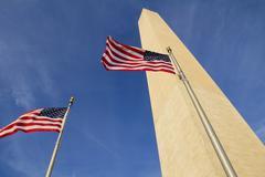 Stock Photo of Washington Monument and waving United States flags