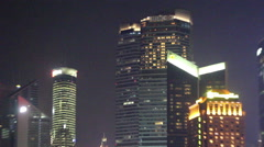 Neon lights on oriental pearl tower and skyscrapers in Shanghai Pudong Stock Footage