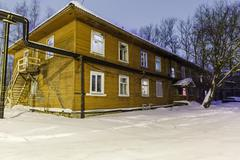 old wooden barracks at winter night - stock photo