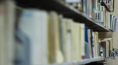 Racking Focus over Books Stock Footage
