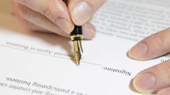 hand puts the signaturehands, signature, hand signing a document - stock footage