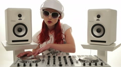 Female Disc Jockey Mixing Music between Stereos Stock Footage