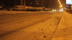 Snowy Night Avenue Traffic Stock Footage