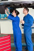 Stock Photo of Team of mechanics working together