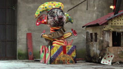 The carnival ended: magic box clown in motion with person Stock Footage