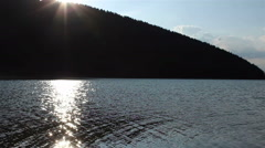 Sun Reflections on Lake Surface Stock Footage