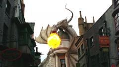 Dragon breathing fire in new Diagon Alley at The Wizarding World of Harry Potter Stock Footage