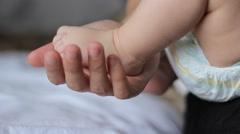 Tiny Baby Foot - stock footage