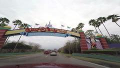 Driving through Disney world gate Stock Footage