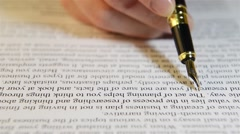 Reading text with a pen, checking text Stock Footage