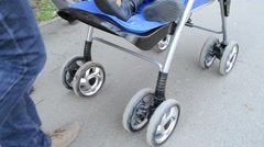Woman Pushing Baby Stroller Stock Footage