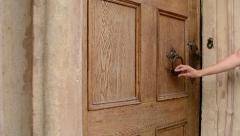 Woman Uses Door Knocker Stock Footage
