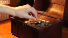 Woman Puts Silver Coin to Chest Stock Footage