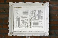Discarded computer board painted in white on frame Stock Photos