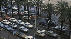 Cannes 1980: heavy traffic in front of the beach - stock footage
