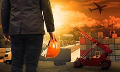 Working man in container dock and land ,air transport ,import export logistic Stock Photos