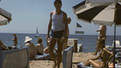 Cannes 1980: people relaxing on the beach - stock footage