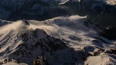 Fog rolling over mountain peak, Pordoi pass, Canazei ski resort 4K - stock footage