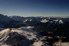 Clouds rolling over mountain summit, Canazei ski resort 6K - stock footage