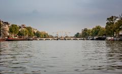 drawbridge on amstel river - stock photo